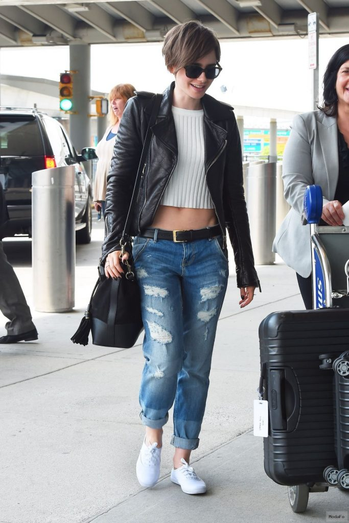 LILY COLLINS in Ripped Jeans at JFK Airport 05/05/2015 …