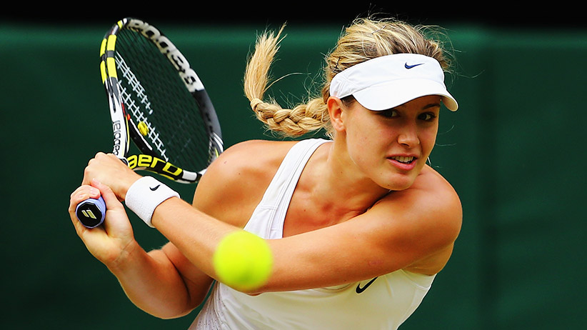 LONDON, ENGLAND - JULY 05:  Eugenie Bouchard of Canada plays a backhand return during the Ladies' Singles final match against Petra Kvitova of Czech Republic on day twelve of the Wimbledon Lawn Tennis Championships at the All England Lawn Tennis and Croquet Club on July 5, 2014 in London, England.  (Photo by Al Bello/Getty Images)